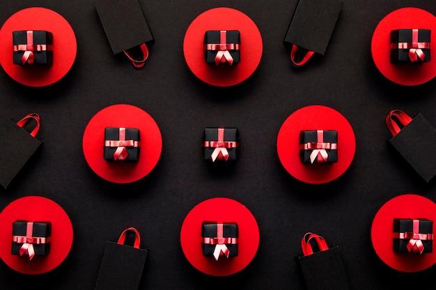 Fundo vermelho e preto de caixas de presente