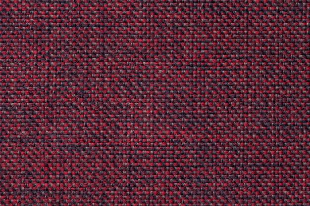 Fundo vermelho e preto de matéria têxtil com teste padrão quadriculado, close up.
