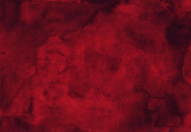 Fundo vermelho escuro da aquarela da textura pintado à mão. fundo de cor vinho tinto em aquarela.
