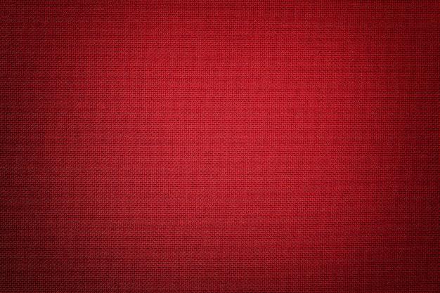 Fundo vermelho escuro de um material têxtil com vime,