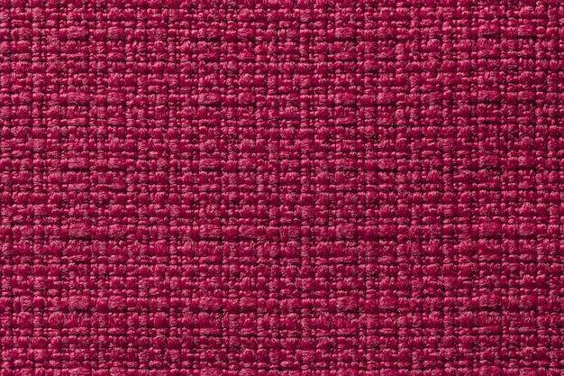 Fundo vermelho escuro de um material têxtil