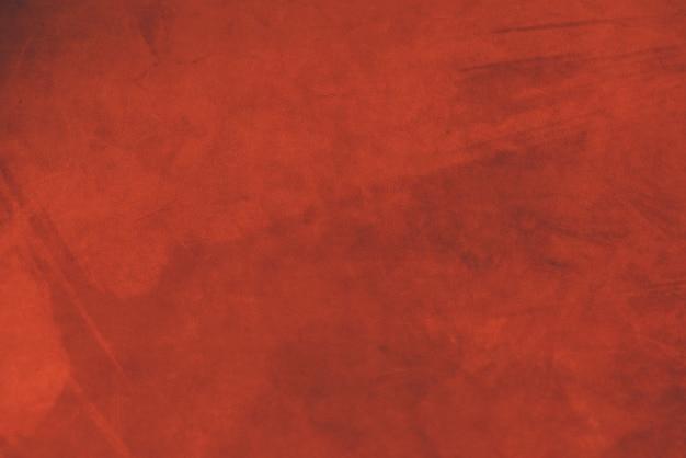 Fundo vermelho fosco de tecido de camurça. textura de veludo de couro sem costura. material de feltro.