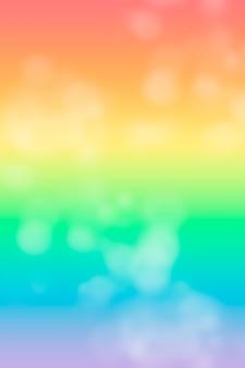 Fundo vertical claro iridescente macio e delicado com bokeh. símbolo lgbt e gradiente de arco-íris.