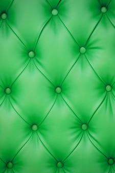Fundo vertical de estofamento de couro verde