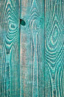 Fundo vertical de três placas texturizadas verdes.