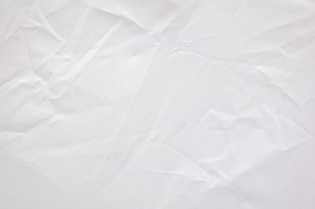 Fundo vincado sumário da textura da tela. padrão de material têxtil branco amassado.