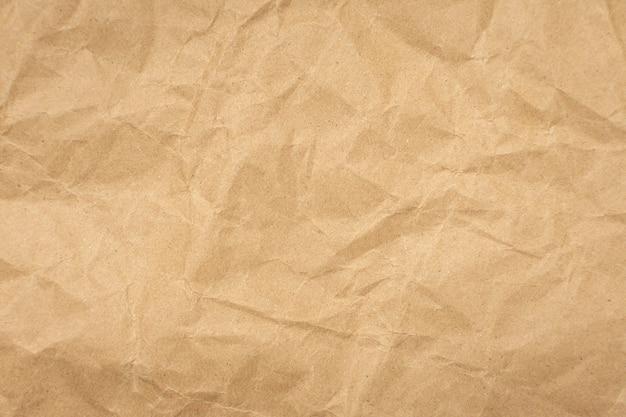 Fundo vintage da textura de papel pardo amassado.