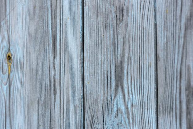 Fundo vintage de prancha vertical de madeira surrada cinza
