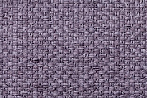 Fundo violeta de matéria têxtil com teste padrão quadriculado, close up. estrutura da macro de tecido.