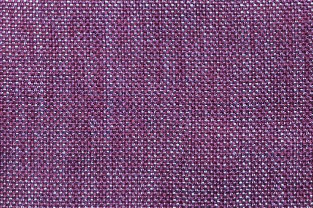 Fundo violeta escuro de matéria têxtil com teste padrão quadriculado, close up. estrutura da macro de tecido.