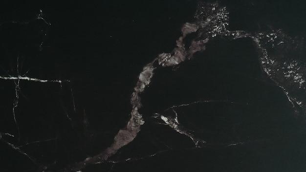 Fundos abstratos de mármore e texturas na cor preta.