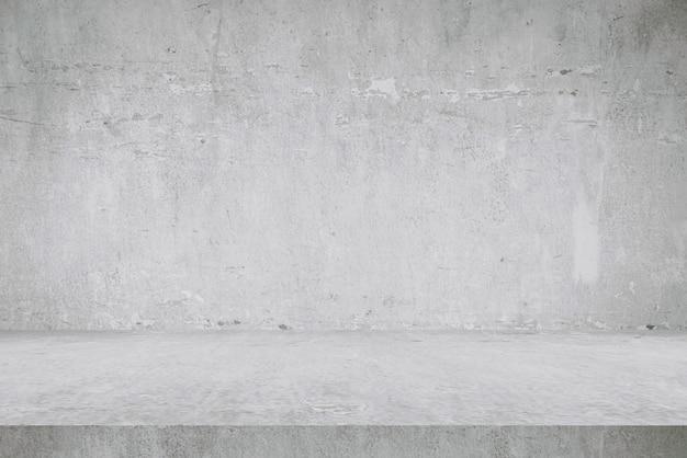 Fundos do assoalho e da parede do cimento da tabela, produtos da exposição da prateleira.