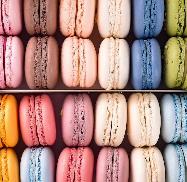 Fundos franceses coloridos dos bolinhos de amêndoa, configuração lisa. feriados e celebrações conceito.
