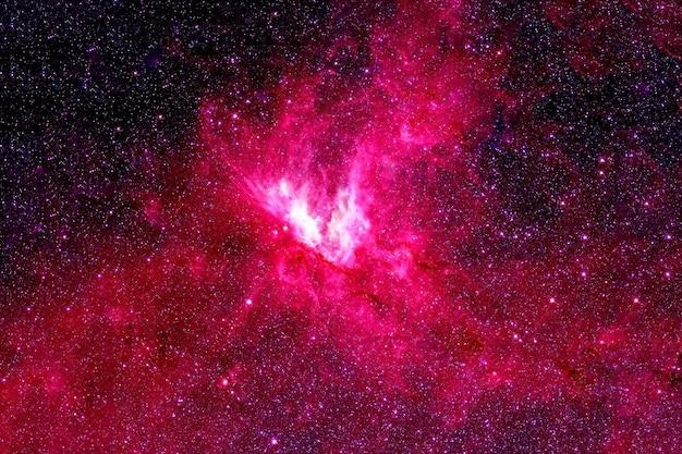 Galáxia vermelha, espaço profundo. com as estrelas. os elementos desta imagem foram fornecidos pela nasa. para qualquer propósito.