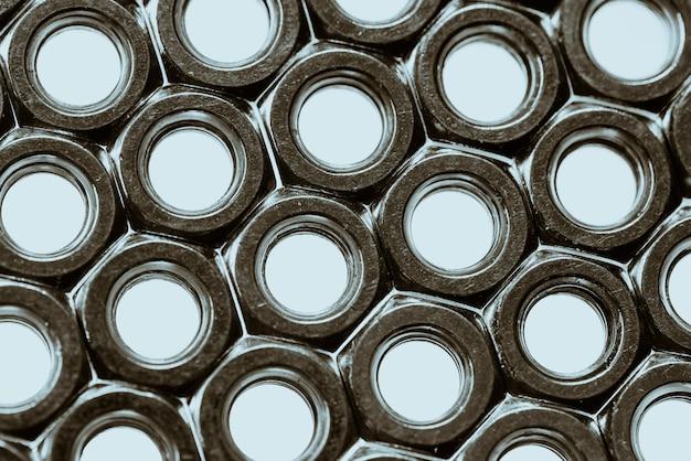 Gama de parafuso feminino. close-up de muitas nozes.