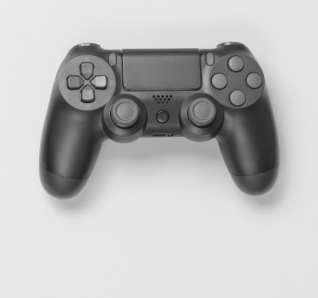 Gamepads em fundo de papel cinza