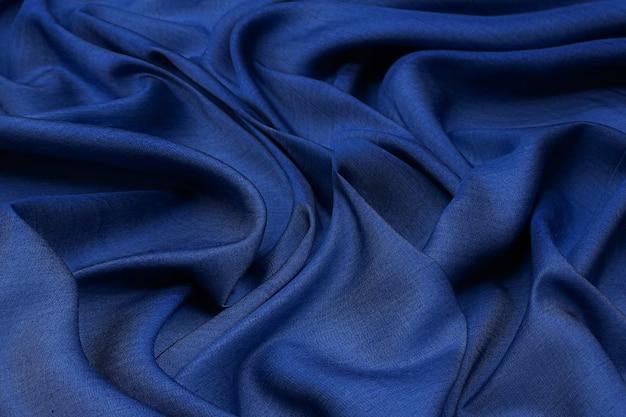 Ganga de algodão. a cor é azul claro. textura, plano de fundo, padrão.