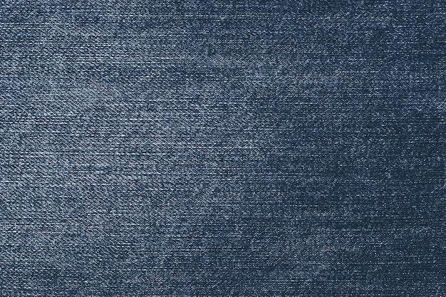 Ganga escura e surrada. fundo azul jeans. padrão de tecido.