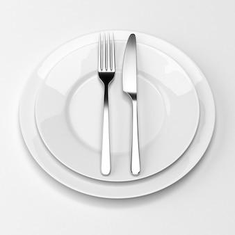 Garfo e faca com pratos