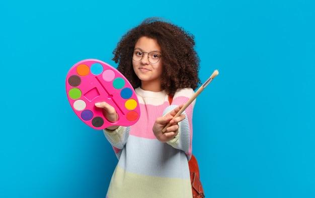 Garota adolescente e bonita artista afro