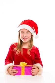 Garota de garoto de natal papai noel feliz animado com presente de fita