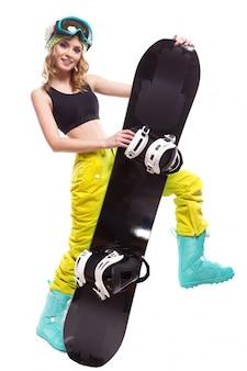 Garota loira e bonita com snowboard