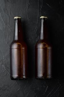 Garrafa de cerveja em pedra preta