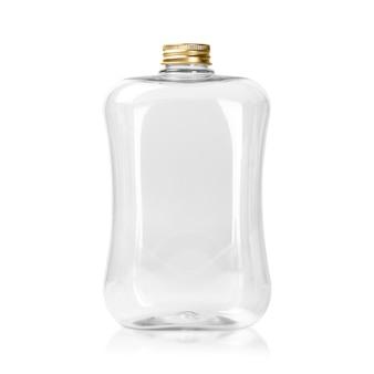 Garrafa plástica vazia com o tampão do ouro isolado no fundo branco. limpar o pacote jar ou mason.