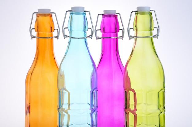 Garrafas de vidro coloridas com tampa hermética