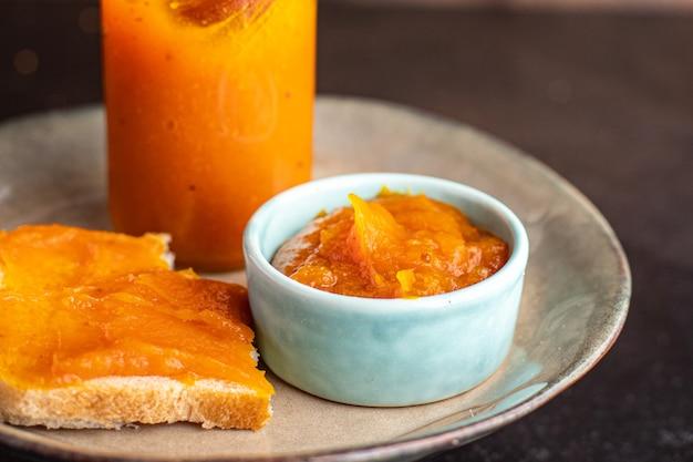 Geléia de abóbora doce sobremesa refeição fresca lanche na mesa cópia espaço comida fundo rústico