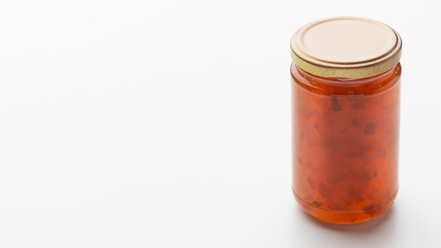 Geléia deliciosa com jar e cópia-espaço
