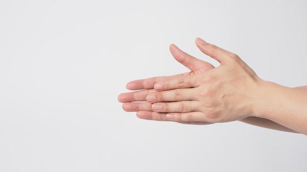 Gesto de lavagem das mãos isoalted em fundo branco.