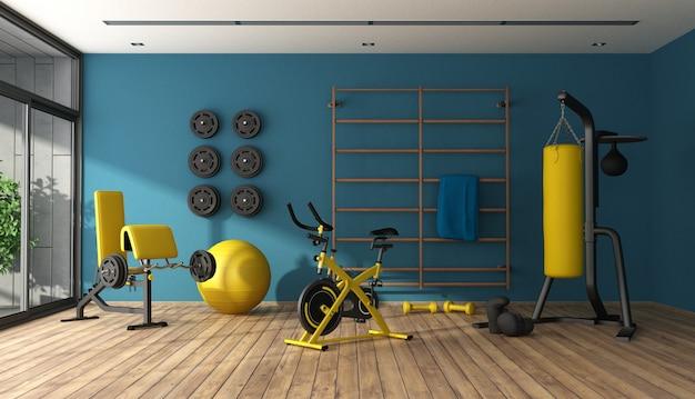 Ginásio em casa azul com equipamento de fitness preto e amarelo