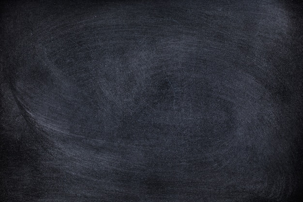 Giz abstrato apagado na textura de lousa ou lousa. limpe o conselho escolar para o fundo ou copie o espaço para adicionar uma mensagem de texto. pano de fundo dos conceitos de educação.