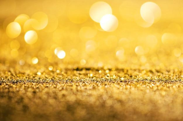 Glitter de luxo ouro de foco abstrato com espaço de cópia