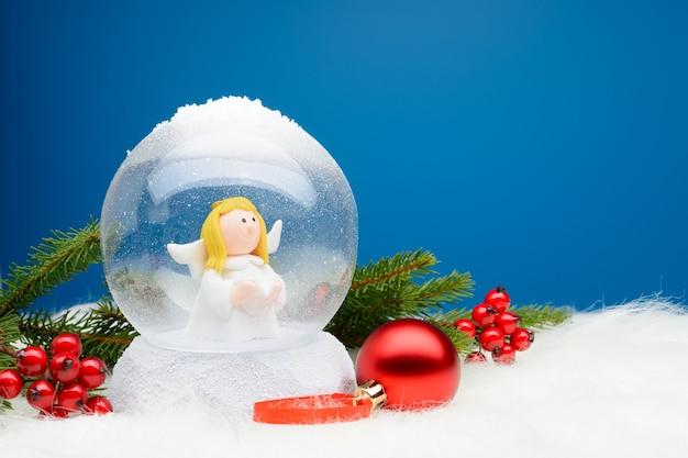Globo de neve decorativo com anjo dentro