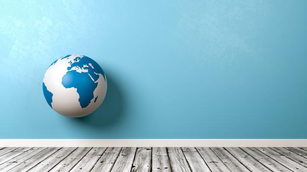 Globo terrestre no chão de madeira contra a parede
