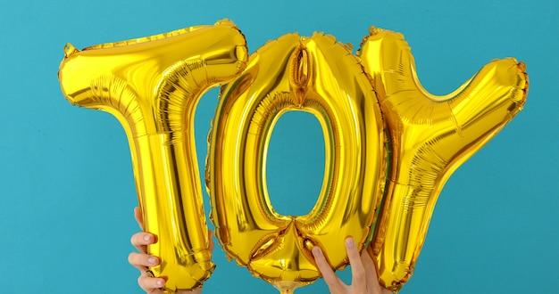 Golden toy palavras feitas de balões infláveis
