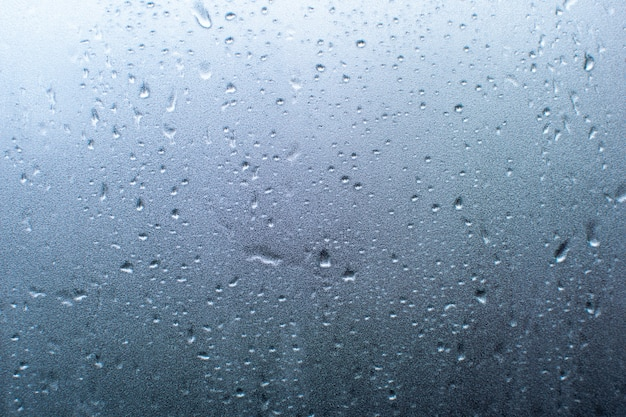 Gota de chuva na janela de vidro