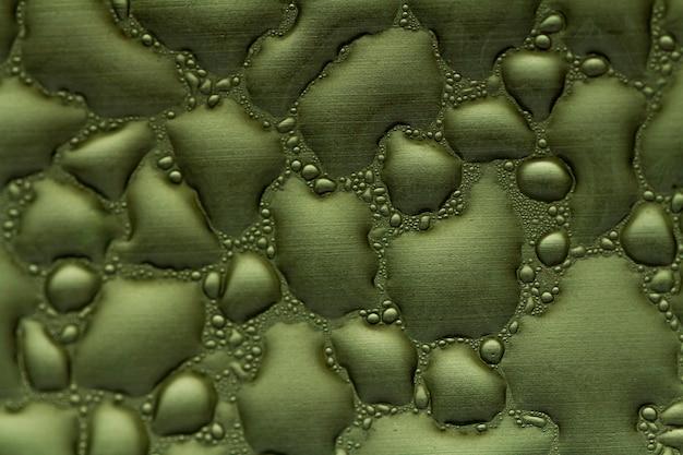Gotas de água na textura de metal