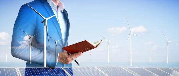 Gráfico de dupla exposição de empresários trabalhando em uma fazenda de turbinas eólicas