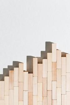 Gráfico de negócio abstrato de peças de madeira