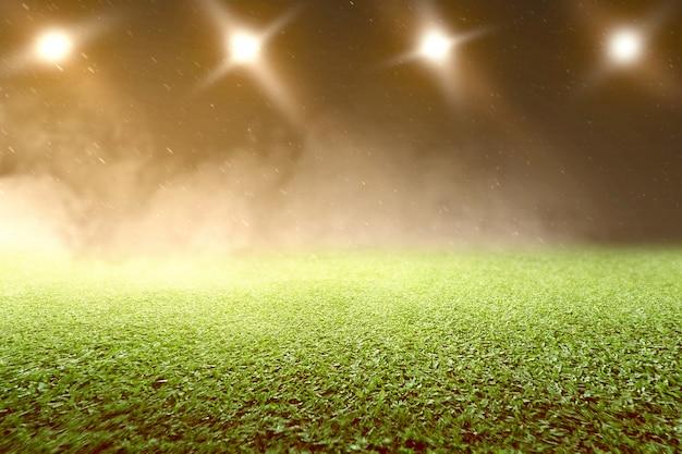 Grama verde com holofotes