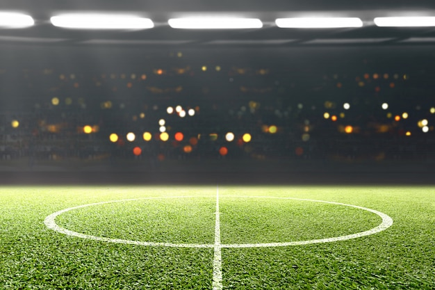 Grama verde e tribuna com luzes desfocadas