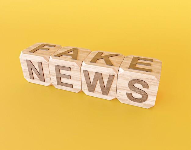 Grande ângulo de cubos de madeira com notícias falsas