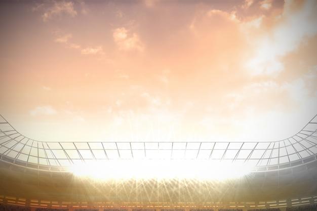 Grande estádio de futebol sob céu azul nublado