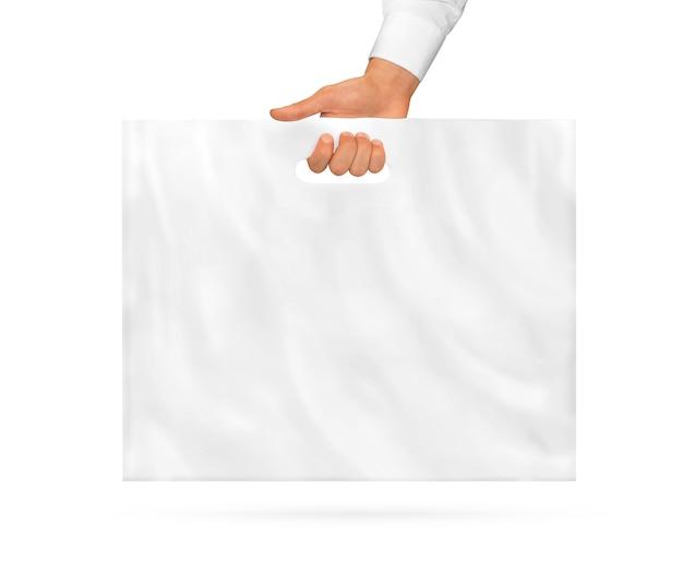 Grande sacola de plástico em branco simulada segurando na mão