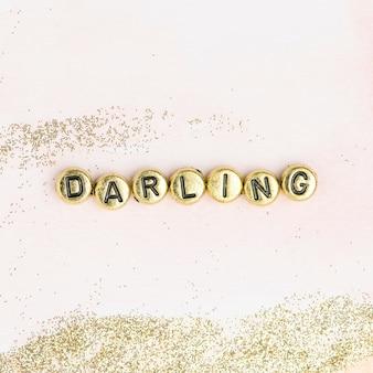 Grânulos queridos com letras de palavras tipografia