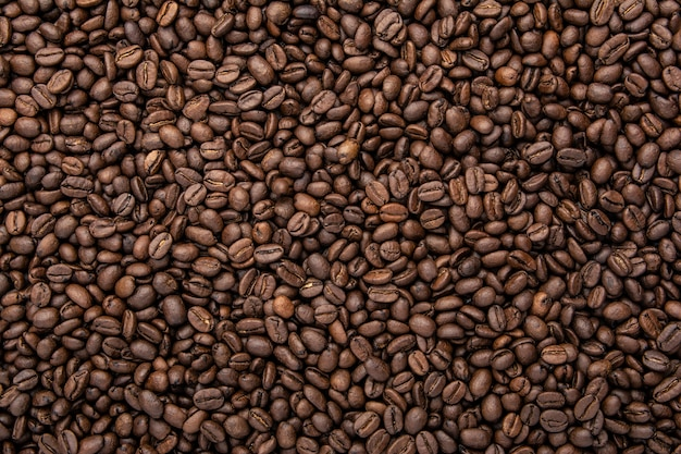 Grãos de café. grãos de café torrados. fundo de café