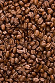 Grãos de café marrons para plano de fundo e textura